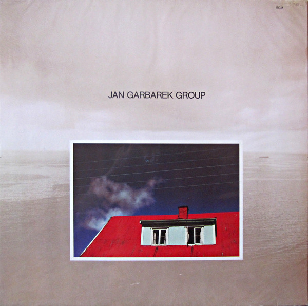 Jan Garbarek Group — Photo with Blue Sky, White Cloud, Wires, Windows and a Red Roof