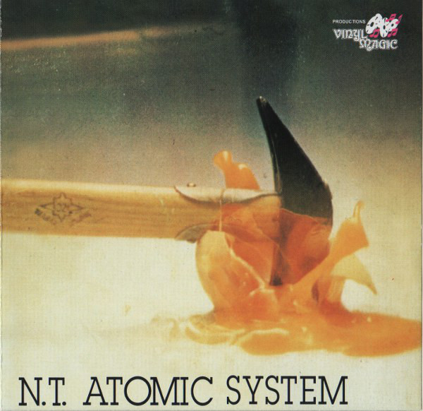 N.T. — Atomic System